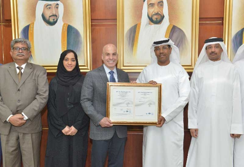 Ahmed Omar Abdulla (second from right), CEO of Borouge, receives the new ISO 9001:2015 certification from Dominic Townsend, vice president, Management System Certification (International) of ABS Global.