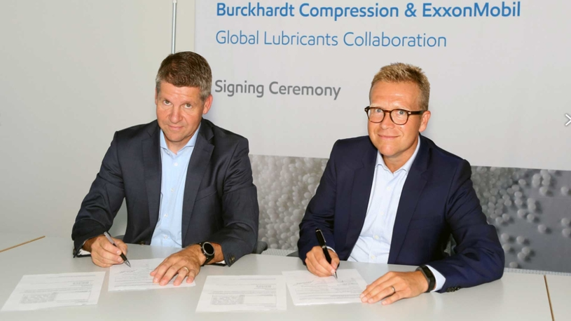Martin Wendel (left), president of services division at Burckhardt Compression, and Gerald De Causemaeker, director, finished lubricants, EAME, ExxonMobil, sign the agreement.