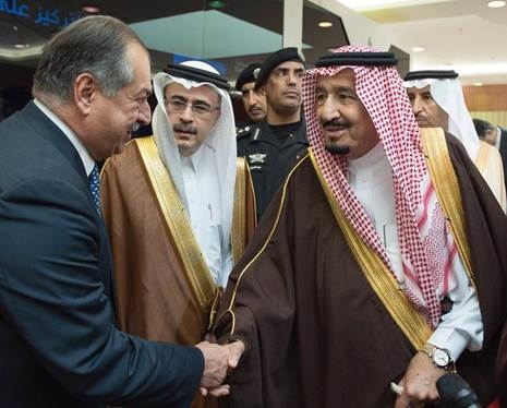 In this file photo, King Salman bin Abdul-Aziz Al Saud is being greeted by Andrew Liveris, chairman of Dow Chemical, in the presence of Amin Nasser, CEO of Saudi Aramco.