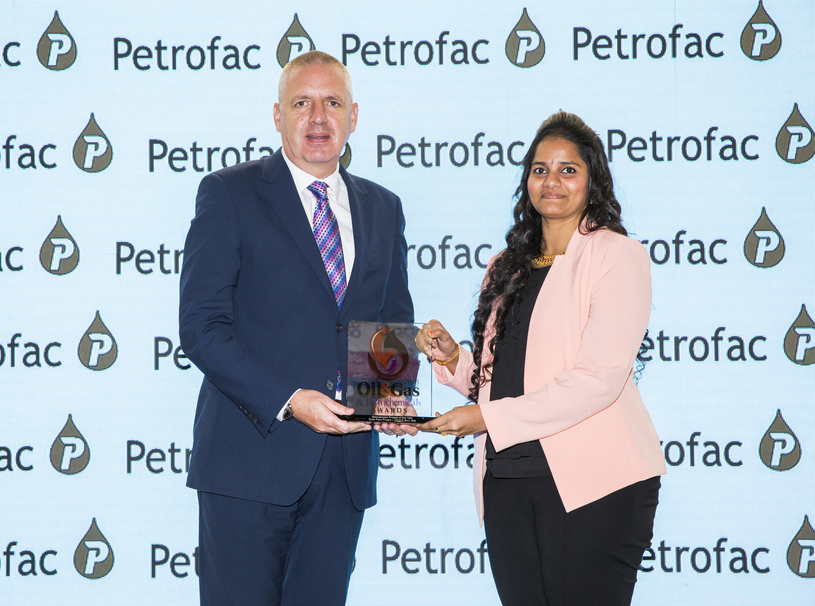 Sudha Nakka Papisetty (right), team leader, HSE planning and performance, ADNOC Sour Gas, receives the 2018 'Downstream Project of the Year' Award, won by of ADNOC Sour Gas, from Simon Lyons, vice president, business development, Petrofac.