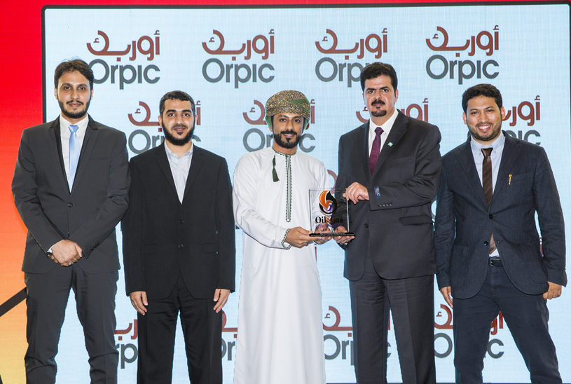 Ahmed Al Hadhrami (centre), senior media relation specialist at Orpic, presents the 2018 'Operational Excellence Strategy of the Year' Award, won by the Zero Ethane Flaring Project by Yanbu NGL Fractionation Department (YNGLFD), part of Saudi Aramco, to Mohammed Al-Otaibi (second from right), operations division head of YNGLFD.