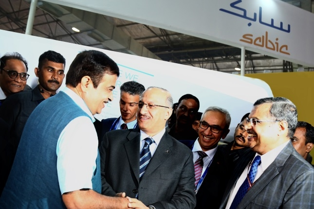 Yousef Al-Benyan, vice chairman and CEO, SABIC, greets Nitin Gadkari, minister, Ministry of Road Transport and Highways, Ministry of Shipping, Ministry of Water Resources, River Development and Ganga Rejuvenation, Government of India, at the SABIC booth at India Chem 2018, in Mumbai.