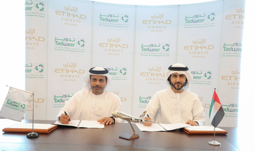 Dr Salem Al Kaabi (left), acting general manager of Tadweer, with Mohammad Al Bulooki, chief operating officer at Etihad Aviation Group, during the signing of the MoU.