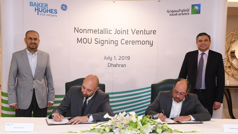 Senior officials from Saudi Aramco and Baker Hughes sign the joint venture agreement.