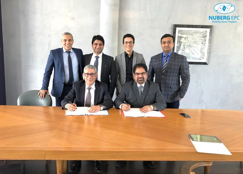 AK Tyagi (sitting, right), chairman and managing director, Nuberg, Moutawakkil Abdelkebir (sitting, left), general manager, SCE Chemicals, and dignitaries from both companies during the signing ceremony.