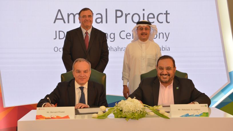 In this file photo from 8 October 2018, Amin H Nasser (standing, right), president and CEO of Saudi Aramco, and Patrick Pouyanné (standing, left), chairman and CEO of Total, witness the signing in Dhahran of the joint development agreement for the FEED of a giant petrochemical complex in Jubail, on Saudi Arabia's eastern coast.